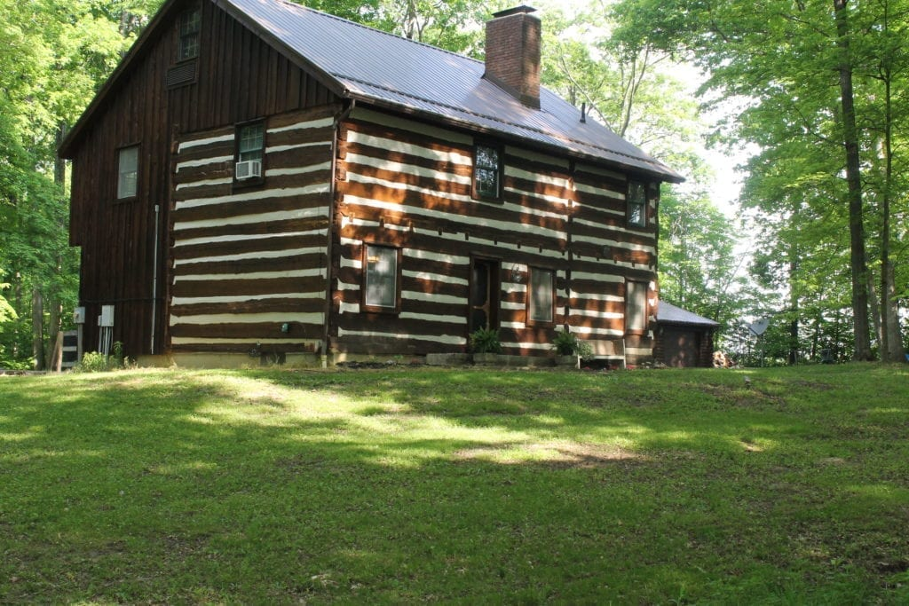 1800's log cabin with board and batten