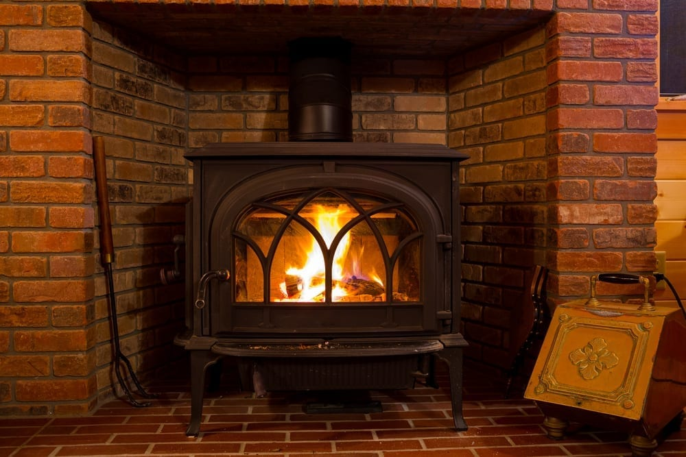 how to heat a wood stove with a log cabin