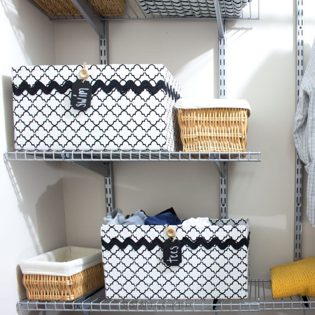 Organize your t-shirts with decorative storage boxes.