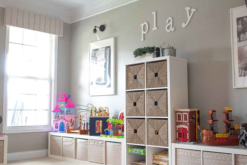 Conceal toy clutter with decorative bins.