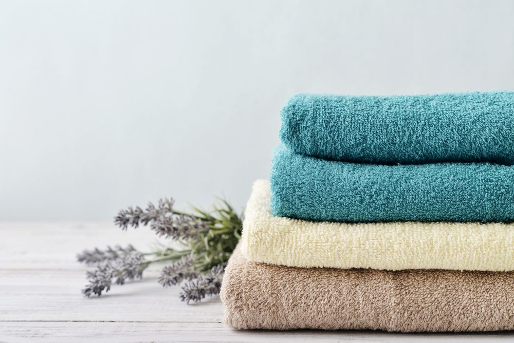 Cleaning out your linen closet? Here's where to donate old towels and why donating is better than throwing away.
